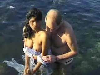 Gallery  1. Libidinous couple having sex on see beach